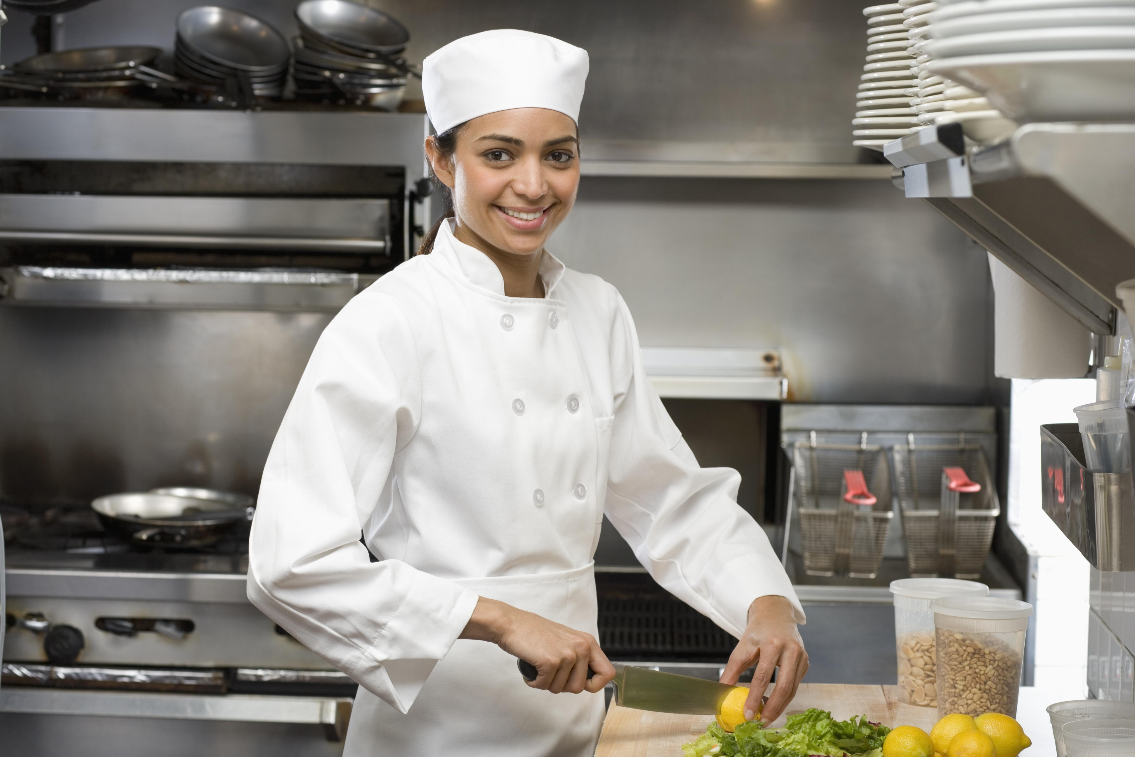 Female chef in restaurant kitchen | Grewal Levy Marketing News