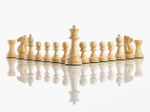 King with team of chess pieces