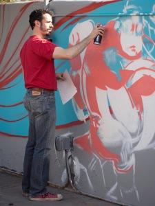 "Artist spray painting on a ""permission wall"" in Tucson, AZ"