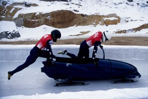 Two man bobsled team pushing off at the start.