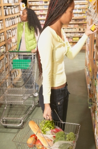 African American women shopping in health food store