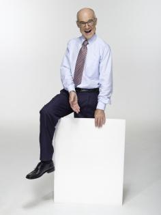 Businessman holding cardboard portrait