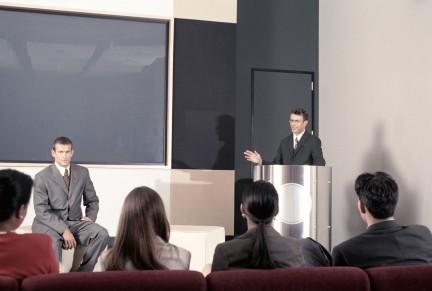 Man Speaking at Business Presentation