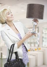 Woman looking at lamp in store