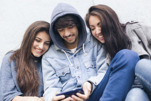 Group of Happy Friends Using a Smart Phone