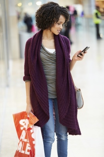 Woman In Shopping Mall Using Mobile Phone